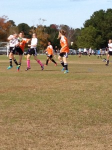 That's Genevieve in the white jersey, blue shoes battling hard!